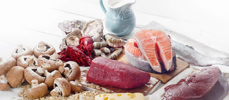Table with raw fish, seafood., mushrooms, vitamin B12 rich foods