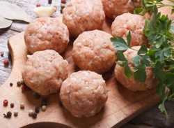 Sesame lamb balls with steamed greens